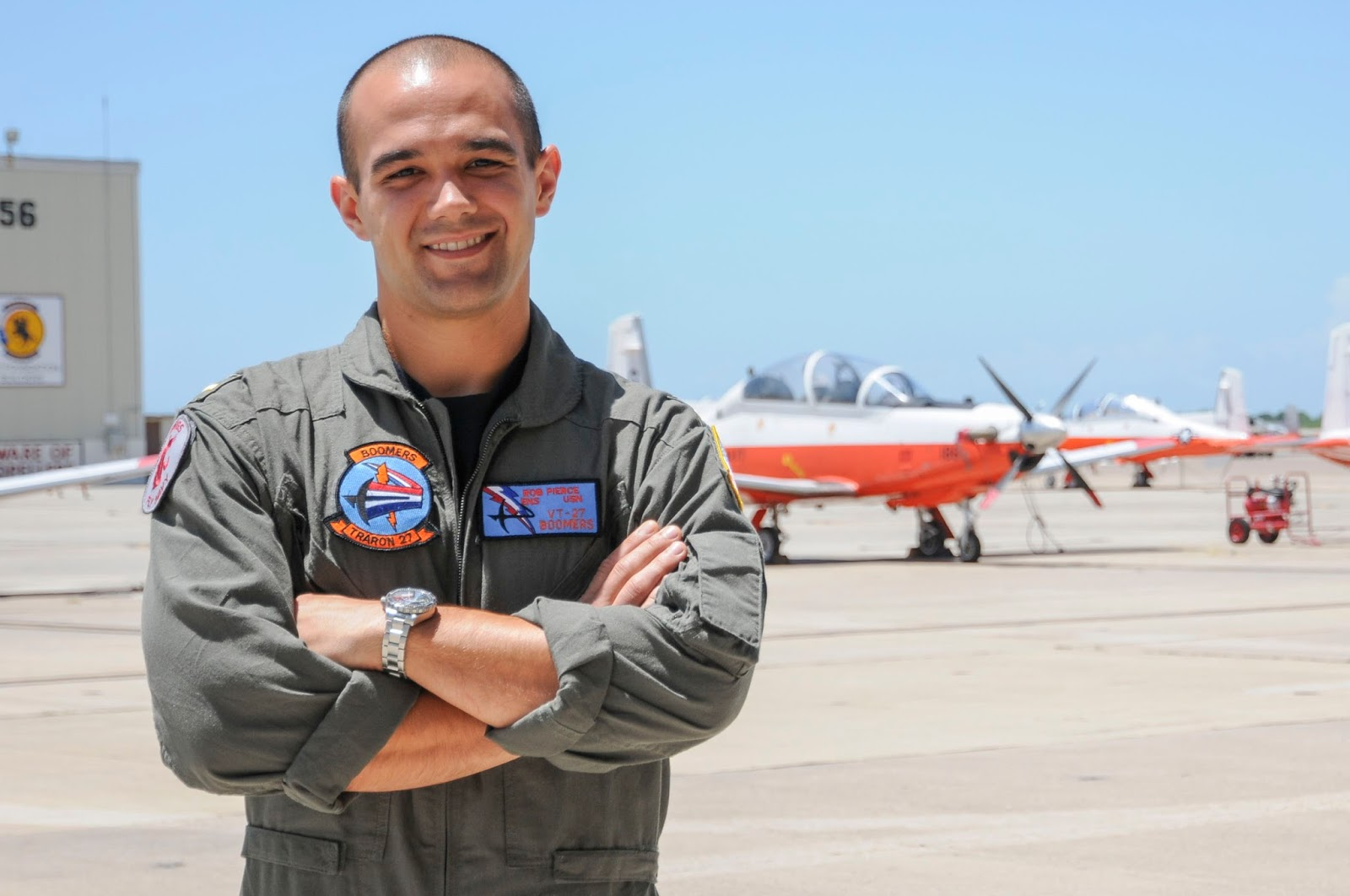 Graduate Robert Pierce standing in front of planes.