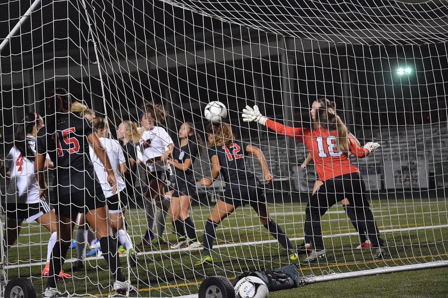 Alyssa Tomasini heads in a corner kick