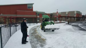 Working hard to clear the snow at Grass Valley Elementary.