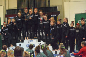 The Camas High School gymnastics team stands on the podium in second place at the 4A state meet Friday, at the Tacoma Dome.  (Dan Trujillo/Post-Record)