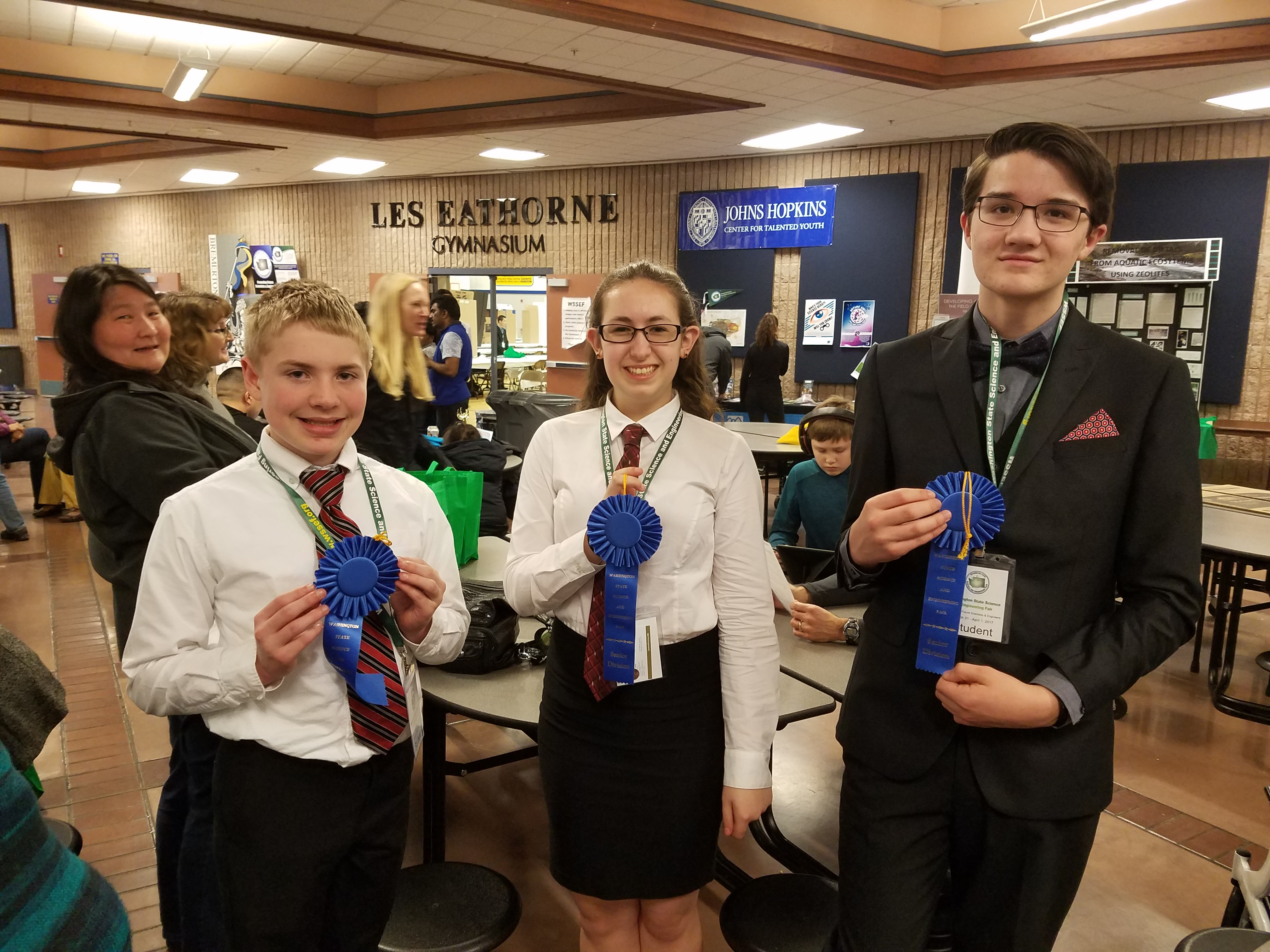 Jordan, Alexis, and Walter show off their blue ribbons.