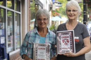 Dawn (Horn ) Coonrod (right) and Audrey (Ladd) Rancore, are pictured holding memory books.