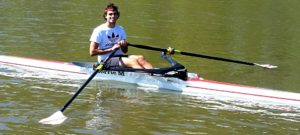 Rhyan Montovino rowing on his boat.