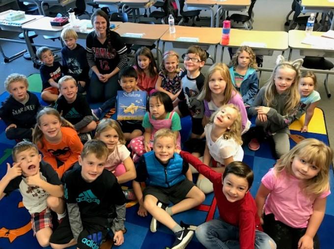Ms. Ziesmer's 1st graders reading Stellaluna