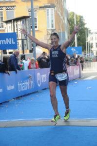 Alisa Wise crosses the finish line
