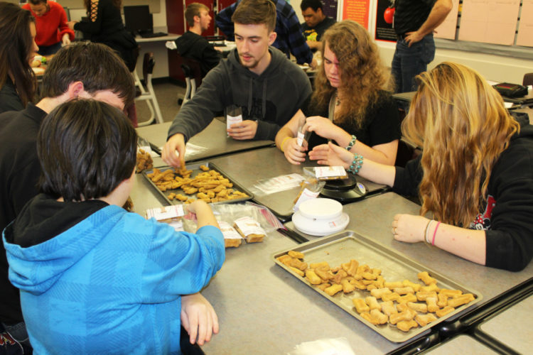 Students team up to make Puppermaker dog treats.