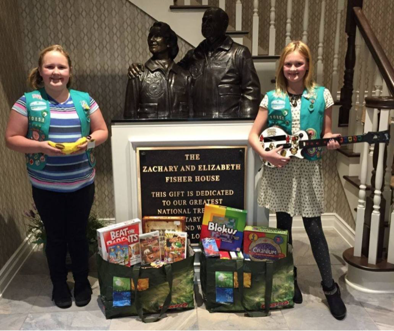 Hines twins with donations