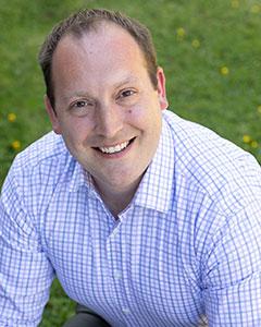 Headshot of board member Corey McEnry